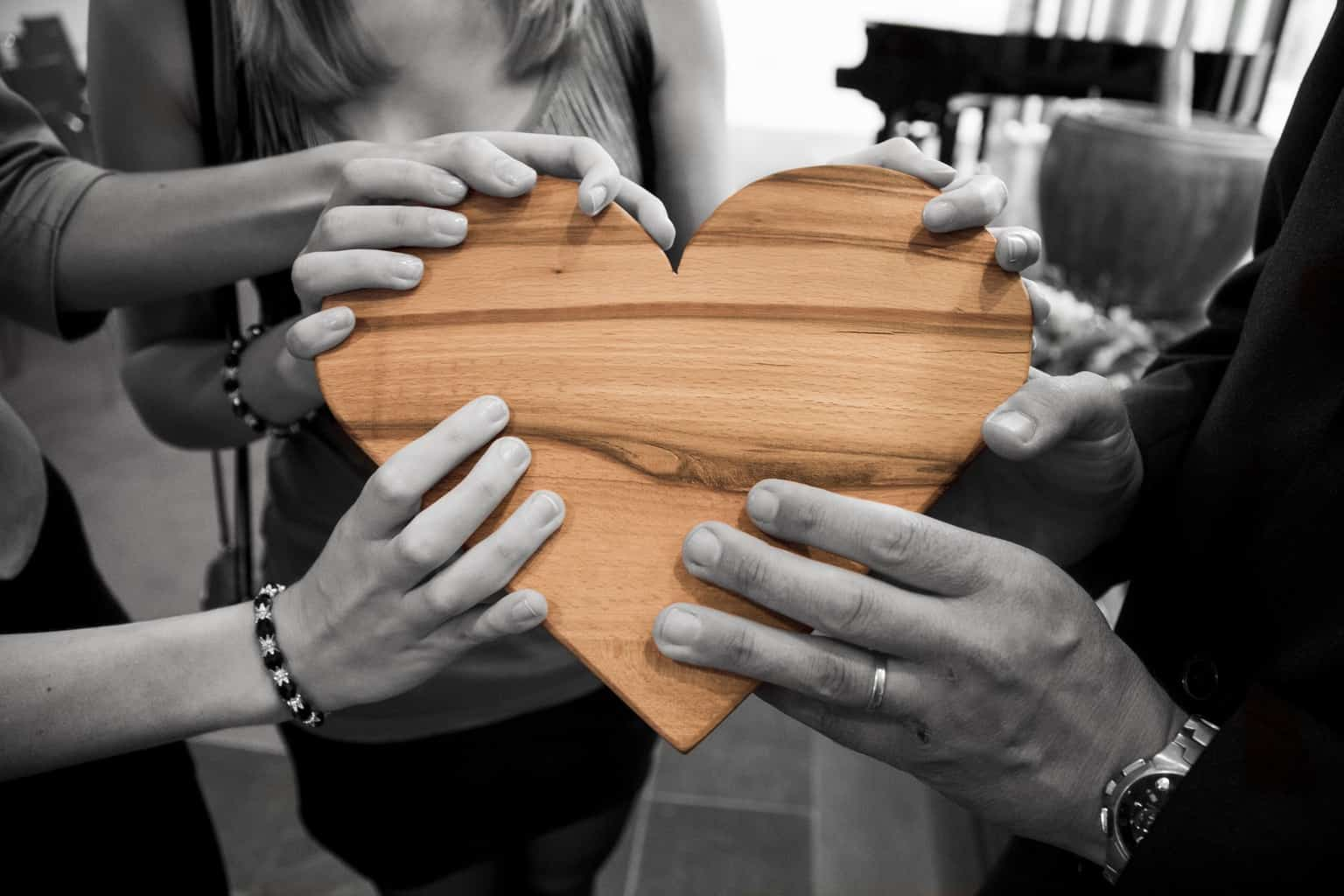 Image of People holding heart