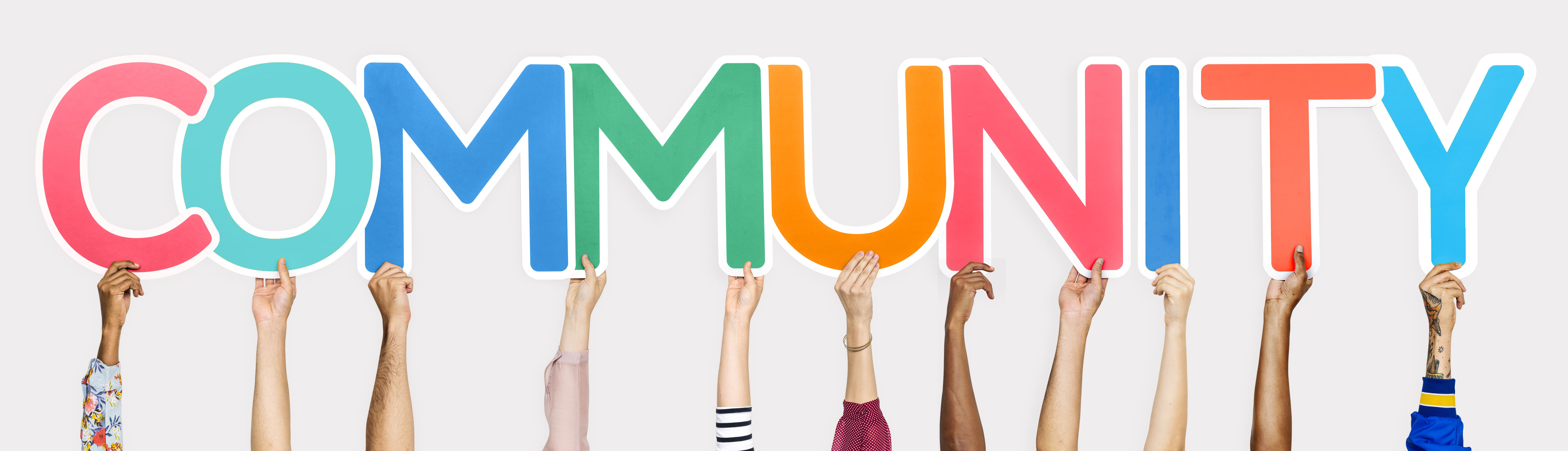 """Image of Hands holding letters that spell """"Community"""""""